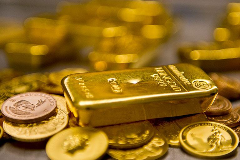Barras y monedas de oro © Michael Gottschalk / Photothek vía Getty Images